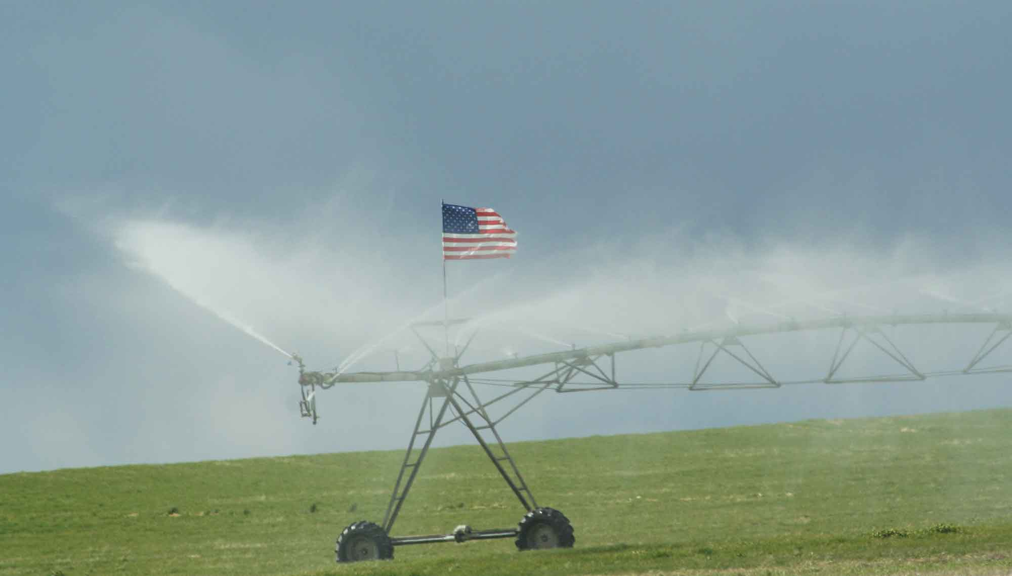 Wheel line with flag in field