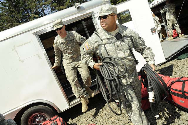 National Guard members from Oregon and Kentucky work to set up a recovery area during the Cascadia Rising exercise