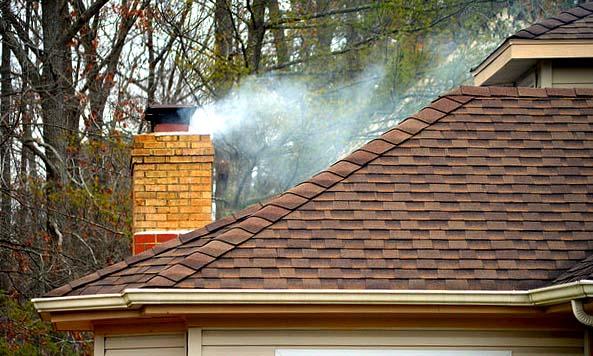 woodsmoke from house chimney