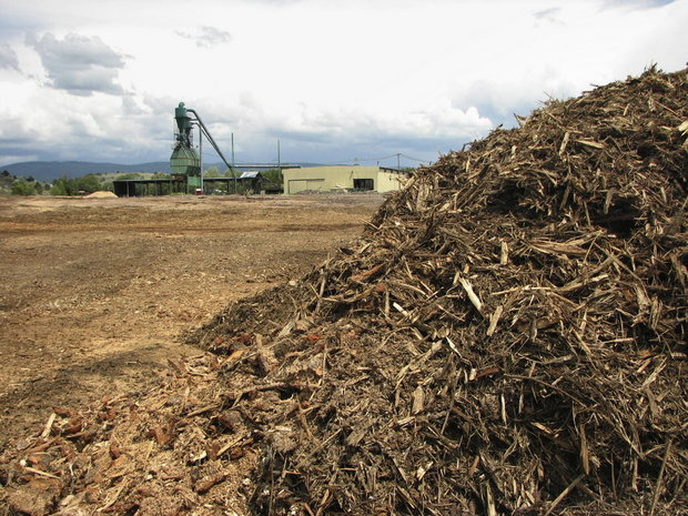 Wood scraps and debris next to a biomass burner at the DR Johnson Company