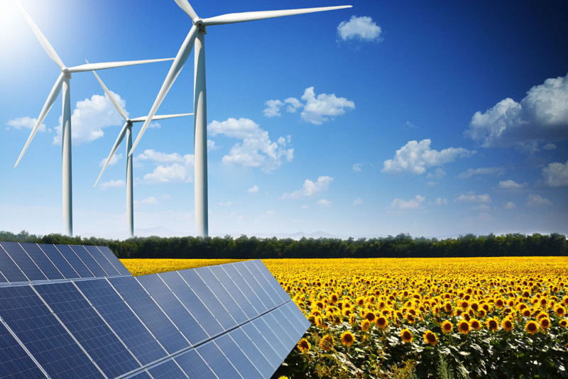Green energy concept with solar panels and wind turbines