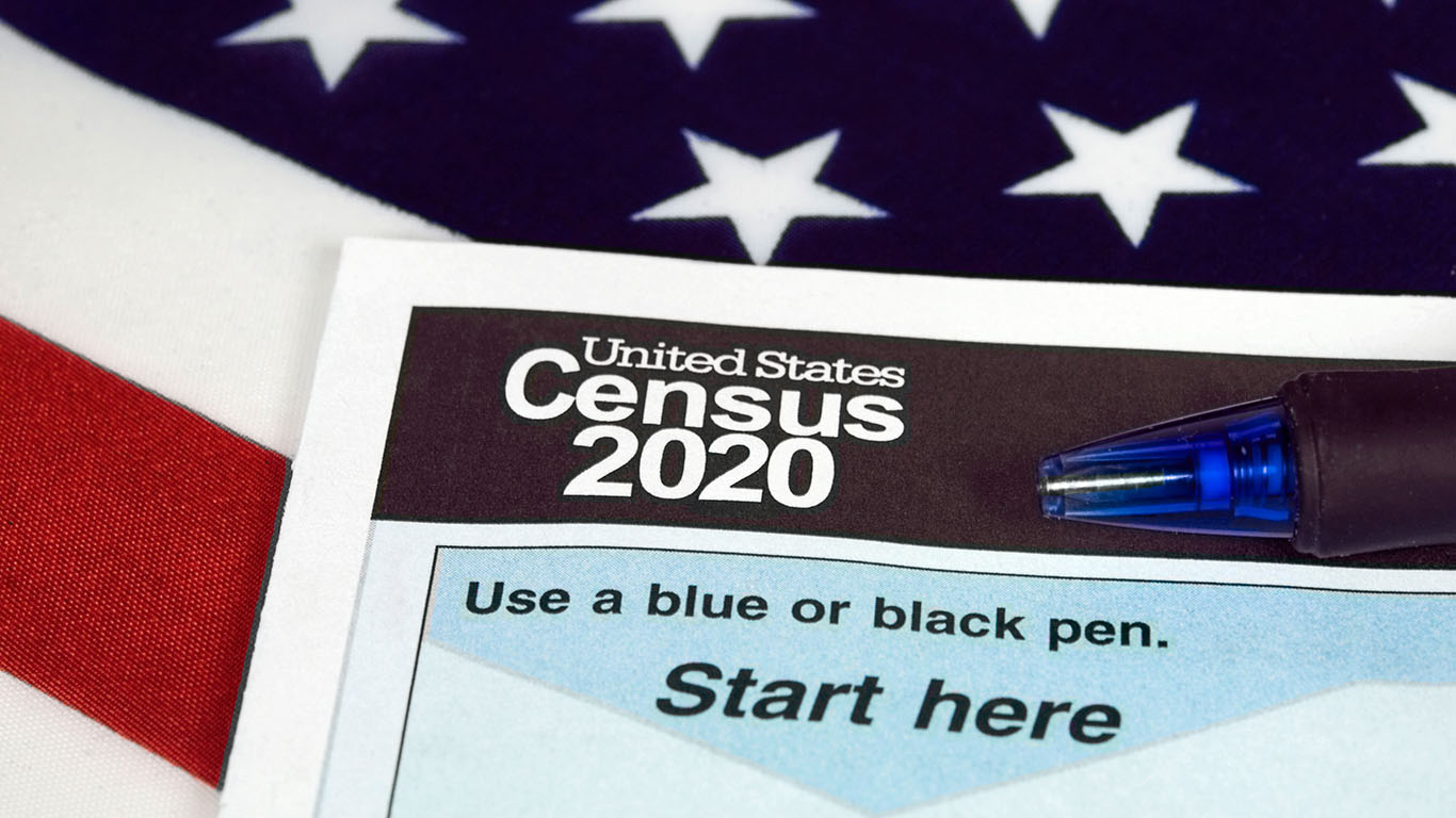 close up of 2020 census document form and ballpoint pen on American flag
