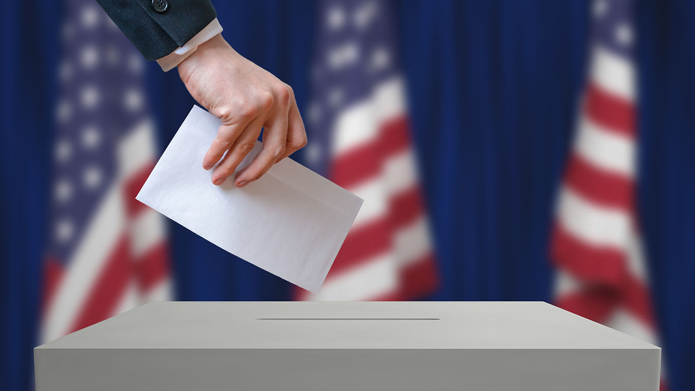 Election in United States of America. Voter holds envelope in hand